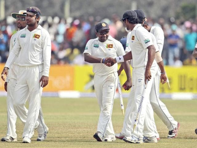 Sri-Lankan-cricketers-congratulate-their-bowler-Rangana-Herath-center-at-the-end-of-the-first-Test-cricket-match-against-England-in-Galle-south-of-Colombo-Herath-completed-a-maiden-10-wicket-match-haul-to-take-Sri-Lanka-to-an-emphatic-win-against-England-despite-Jonathan-Trott-s-defiant-century-threatening-to-steal-the-game-AP-Eranga-Jayawardena
