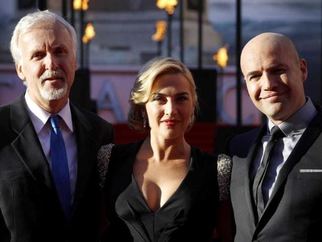 Director James Cameron and actors Kate Winslet and Billy Zane pose at the premiere. (AP Photo)