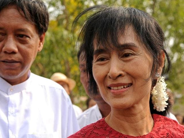 Supporters-of-the-National-League-for-Democracy-NLD-party-cheer-holding-a-portrait-of-Myanmar-pro-democracy-leader-Aung-San-Suu-Kyi-as-they-watch-increasing-votes-on-a-screen-at-the-roof-of-the-NLD-office-in-Yangon-Myanmar-voted-on-Sunday-in-its-third-election-in-half-a-century-REUTERS-Staff