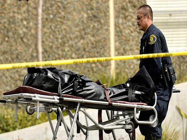 A-sheriff-s-deputy-removes-a-body-from-outside-Oikos-University-in-Oakland-A-gunman-opened-fire-at-the-Christian-university-killing-at-least-seven-people-and-wounding-three-more-AP-Photo-Noah-Berger