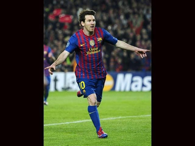 FC-Barcelona-s-Lionel-Messi-reacts-after-scoring-against-AC-Milan-during-the-2nd-leg-quarterfinal-Champions-League-soccer-match-at-the-Camp-Nou-in-Barcelona-Spain-AP-Photo-Manu-Fernandez