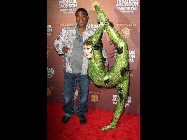 Actor-comedian-Tracy-Morgan-poses-with--Cirque-Du-Soleil-performer-Baska-at-the-Michael-Jackson-The-Immortal-World-Tour-the-Cirque-Du-Soleil-show-honoring-the-late-entertainer-at-Madison-Square-Garden-in-New-York-AP-Photo