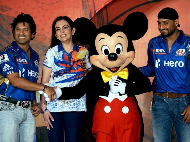 Mumbai-Indians-cricketers-Sachin-Tendulkar-L-team-captain-Harbhajan-Singh-R-and-team-owner-Nita-Ambani-pose-with-Disney-character-Mickey-Mouse-during-an-event-to-unveil-Mickey-Cricket-a-limited-edition-merchandise-range-in-Mumbai-AFP-Indranil-Mukherjee