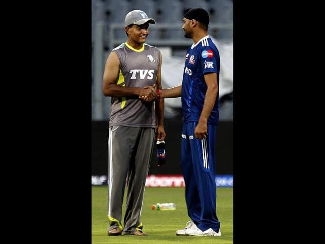 Mumbai-Indians-captain-Harbhajan-Singh-and-Sahara-Pune-Warriors-captain-Sourav-Ganguly-during-the-practice-session-at-Wankhede-Stadium-HT-Kunal-Patil