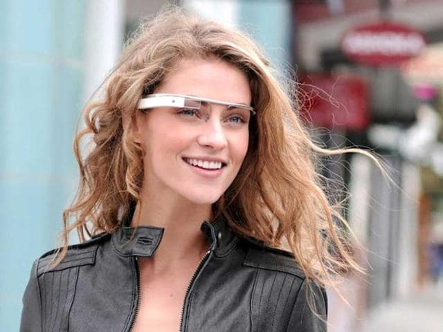 In-this-undated-handout-photo-provided-by-the-Google-x-group-s-Project-Glass-an-early-prototype-of-Google-s-futuristic-Internet-connected-glasses-are-modeled-The-specs-are-said-to-give-you-directions-let-you-video-chat-shop-and-do-everything-else-you-now-need-a-handheld-gadget-to-accomplish-Google-gave-a-glimpse-of-Project-Glass-in-a-video-and-blog-post-this-week-AP-Photo-Google