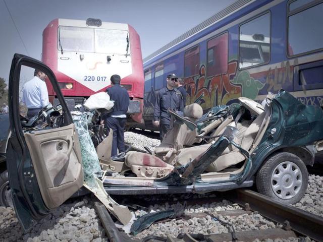 Rescuers-stand-next-to-the-wreckage-of-a-car-that-was-hit-by-a-train-in-an-accident-that-killed-four-people-at-Kryoneri-on-the-northern-fringes-of-Athens-AP-Michail-Michailidis