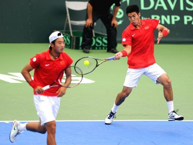 Li-Zhe-R-of-China-returns-the-ball-to-Taiwan-s-Hsieh-Cheng-peng-and-Lee-Hsin-han-as-his-partner-Zhang-Ze-looks-on-during-the-doubles-match-of-the-Davis-Cup-Oceania-Zone-Group-1-in-the-southern-Kaohsiung-city-on-March-7-2012-China-beat-Taiwan-7-6-7-6-6-3-AFP