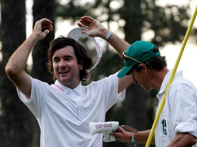 Bubba-Watson-of-the-United-States-celebrates-with-his-caddie-Ted-Scott-after-winning-his-sudden-death-playoff-on-the-second-playoff-hole-to-win-the-2012-Masters-Tournament-by-one-stroke-at-Augusta-National-Golf-Club-in-Augusta-Georgia-
