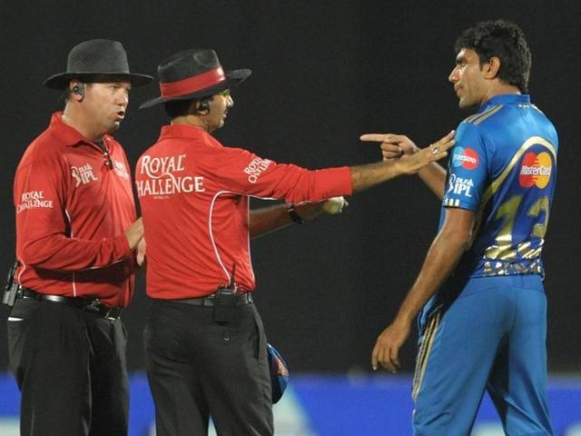 Mumbai-Indians-bowler-Munaf-Patel-argues-with-umpires-about-the-wicket-of-Deccan-Chargers-captain-Kumar-Sangakkara-during-the-IPL-Twenty20-cricket-match-at-Dr-YS-Rajasekhara-Reddy-Cricket-Stadium-in-Visakhapatnam-AFP-Photo