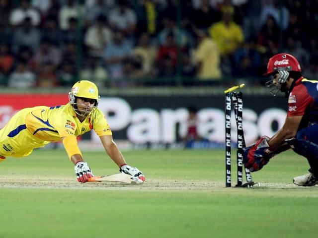 Delhi Daredevils wicketkeeper Naman Ojha (R) runs out Chennai Super Kings batsman Suresh Raina (L) during the IPL Twenty20 cricket match at the Feroz Shah Kotla stadium in New Delhi. AFP Photo/Manan Vatsyayana