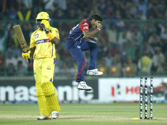 Umesh Yadav of Delhi Daredevils, right, Dwayne Bravo of Chennai Super Kings, unseen, during their IPL Twenty20 cricket match vs Chennai Super Kings in New Delhi. AP Photo/Saurabh Das