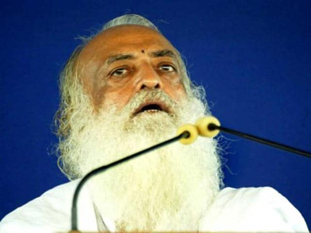 Asaram-Bapu-addresses-supporters-at-the-sect-s-Ashram-Spiritual-Centre-on-the-outskirts-of-Ahmedabad-AFP-Photo-Sam-Panthaky