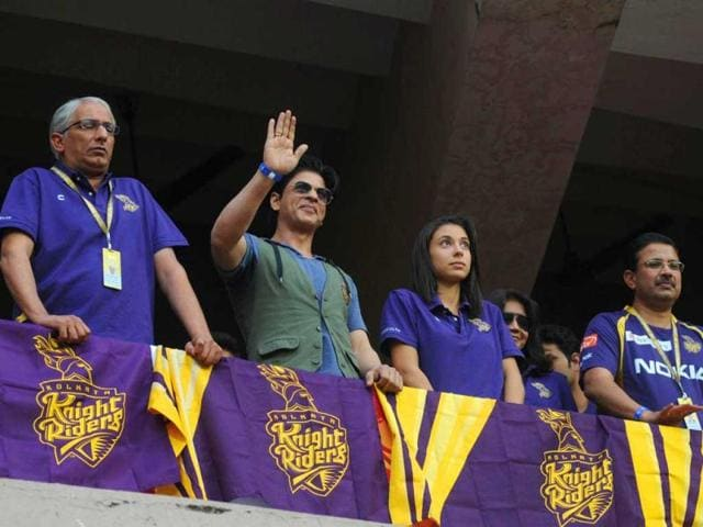 Kolkata Knight Riders owner Shah Rukh Khan greets fans during the IPL Twenty-20 cricket match.