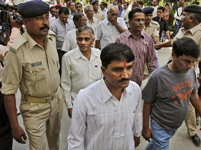 Policemen-escort-men-charged-for-involvement-in-the-2002-riots-at-Ode-village-into-the-district-court-in-Anand-Gujarat-AP-Ajit-Solanki