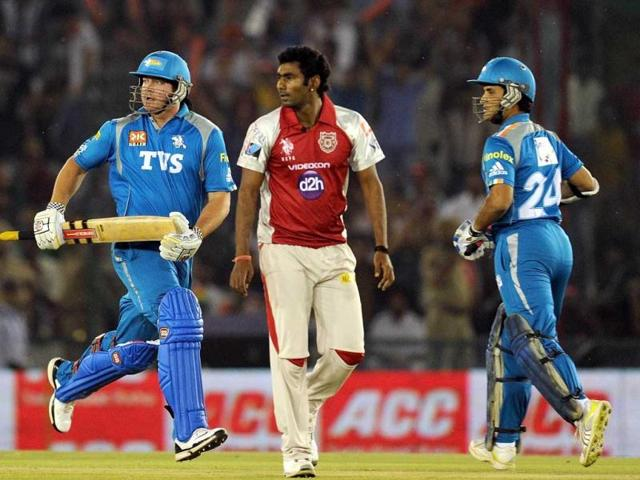 Kings-XI-Punjab-bowler-Parvinder-Awana-C-watches-as-Pune-Warriors-batsman-Jesse-Ryder-L-and-Saurav-Gangulay-run-between-the-wickets-during-the-IPL-Twenty20-cricket-match-between-Kings-XI-Punjab-and-Pune-Warriors-at-PCA-Stadium-in-Mohali-AFP-Photo-Prakash-Singh