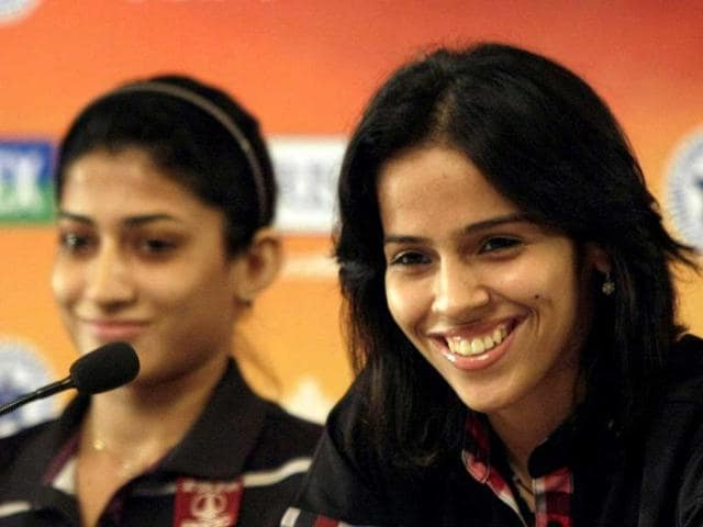 Shuttlers-Ashwani-Ponnappa-and-Saina-Nehwal-R-at-a-press-conference-ahead-of-the-second-edition-of-Yonex-Sunrise-India-Open-2012-OSIM-BWF-World-Superseries-badminton-tournament-in-New-Delhi-HT-Photo-M-Zhazo