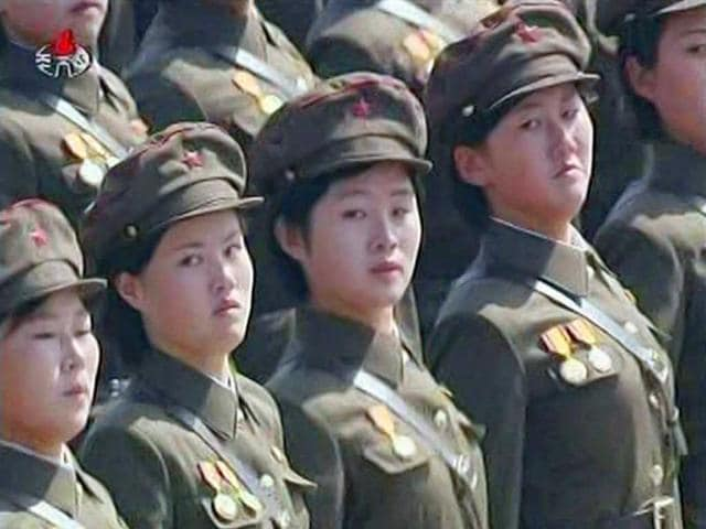 Female-North-Korean-soldiers-take-part-in-a-mass-parade-to-celebrate-founder-Kim-Il-sung-s-100th-birthday-in-Pyongyang-in-this-still-image-taken-from-a-video-North-Korea-s-leader-Kim-Jong-un-led-celebrations-on-Sunday-to-mark-the-centenary-of-the-birth-of-his-grandfather-the-founder-of-the-world-s-only-Stalinist-monarchy-Eternal-President-Kim-Il-sung-Reuters-KRT-via-Reuters-TV