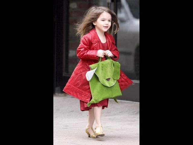 Suri Cruise reportedly wants to be an Olympic gymnast after watching the 2012 Olympic games. The six-year-old daughter of actor Tom Cruise and Katie Holmes was so impressed with America's gold winner Gabby Douglas,she wants to follow in her footsteps.,gymnast