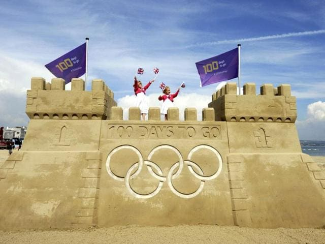 Children-stand-on-a-giant-sand-castle-built-on-Weymouth-beach-to-mark-100-days-to-go-to-the-London-2012-Olympic-Games-in-Weymouth-southern-England-Weymouth-and-Portland-will-host-the-Olympic-and-Paralympic-sailing-at-the-London-2012-Olympic-and-Paralympic-Games-The-photograph-was-taken-to-mark-the-100-days-milestone-which-is-on-Reuters-Locog-Handout