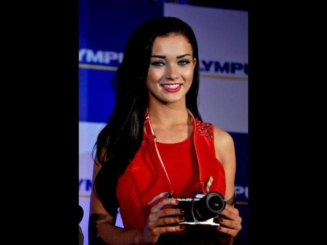 Amy Jackson is clearly the Woman in Red.
