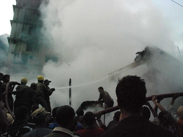 Fire-fighters-try-and-douse-out--a--fire-at-the-the-main-market-square-of-Darjeeling-town-HT-Photo-Amitava-Banerjee