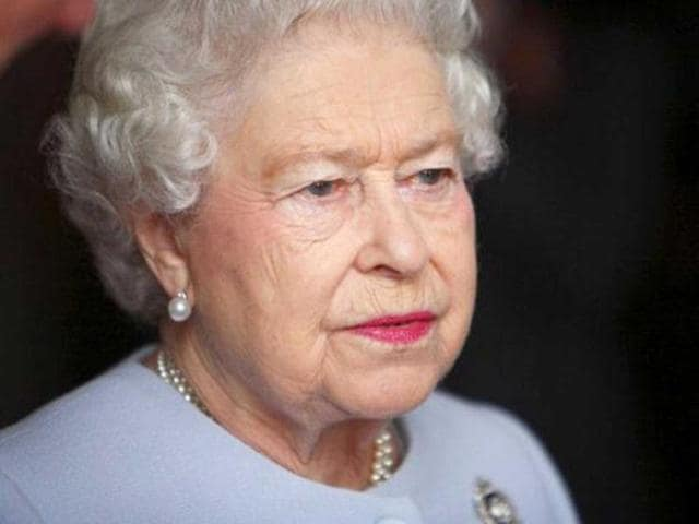 Britain-s-Queen-Elizabeth-II-points-from-the-catamaran-Pure-Adrenalin-during-the-royal-boat-tour-along-the-Brisbane-River