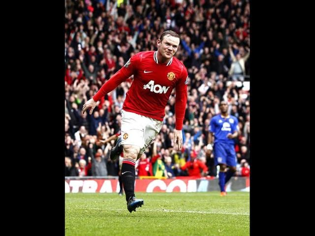 Manchester-United-s-Wayne-Rooney-reacts-after-scoring-his-second-goal-against-Everton-during-their-English-Premier-League-soccer-match-at-Old-Trafford-Stadium-Manchester-England-AP-Photo-Jon-Super
