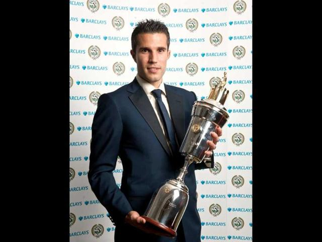 Arsenal-s-Robin-Van-Persie-holds-the-trophy-after-he-was-named-the-Professional-Footballers-Association-Player-of-the-Year-during-the-2012-PFA-Player-of-the-Year-Awards-at-the-Grosvenor-House-Hotel-in-London-AP-Photo-PA