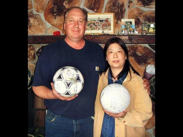 David-and-Yumi-Baxter-hold-a-soccer-ball-and-a-volleyball-which-David-found-at-their-house-in-Alaska-Kyodo-News-agency-says-the-teenage-owner-of-the-soccer-ball-that-apparently-floated-across-the-Pacific-Ocean-after-last-year-s-tsunami-is-surprised-and-thankful-the-ball-which-had-his-name-written-on-it-was-found-in-Alaska-AP-Photo-The-Baxters-via-Kyodo-News