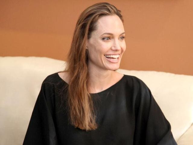Actress-Angelina-Jolie-sports-an-engagement-ring-as-she-and-Brad-Pitt-view-works-from-the-Chinese-collection-at-the-The-Los-Angeles-County-Museum-of-Art-in-Los-Angeles-AP-Photo-Robert-Procop-The-Communications-Group