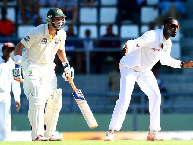 West-Indies-bowler-Shane-Shillingford-R-and-Australian-batsman-Michael-Hussey-react-during-the-first-day-of-the-third-Test-match-in-Roseau-Dominica-Australia-is-leading-the-the-three-Test-series-1-0-AFP-Emmanuel-Dunand
