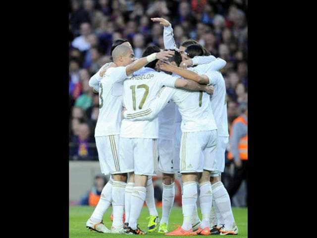 Real-Madrid-s-teammates-celebrate-after-Mesut-Ozil-from-Germany-scored-against-FC-Barcelona-during-their-Spanish-La-Liga-soccer-match-at-Camp-Nou-stadium-in-Barcelona-Spain-AP-Alvaro-Barrientos