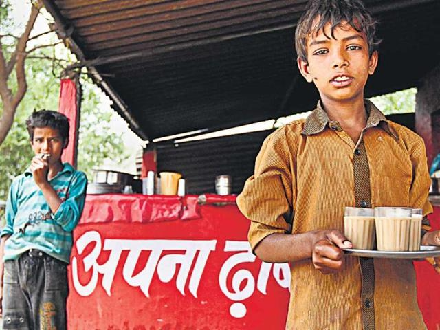 A-boy-at-a-tea-stall-in-Taoru-in-the-Mewat-region-of-Haryana-The-RTE-Act-bars-children-between-6-and-14-years-of-age-from-working---Sanjeev-Verma-HT-Photo