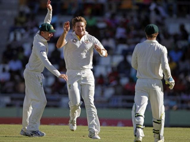Australia-s-Shane-Watson-center-celebrates-with-his-captain-Michael-Clarke-left-and-the-wicket-keeper-Matthew-Wade-after-taking-the-wicket-of-West-Indies-Darren-Bravo-who-was-caught-behind-for-45-runs-during-the-second-innings-on-the-fourth-day-of-their-third-and-final-cricket-Test-match-in-Roseau-Dominica-AP-Andres-Leighton