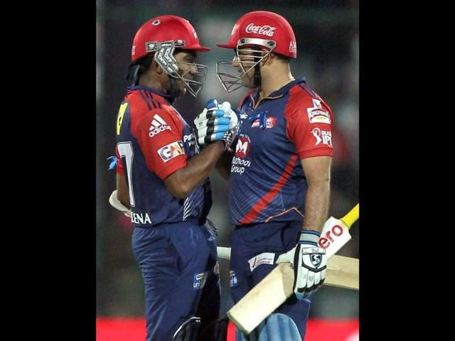 Delhi-Daredevils-Mahela-Jayawardene-celebrates-his-half-century-with-Virender-Sehwag-against-Mumbai-Indians-during-their-IPL-5-match-in-New-Delhi-PTI-Photo-Aman-Sharma