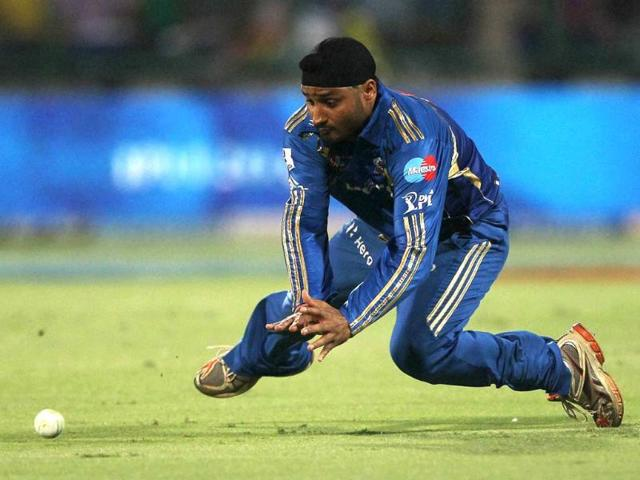 Mumbai-Indians-captain-Harbhajan-Singh-attempts-to-stop-the-ball-against-Delhi-Daredevils-during-their-IPL-5-match-in-New-Delhi-PTI-Photo-Aman-Sharma