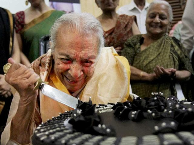 File photo: Veteran actress Zohra Sehgal reacts while cutting a cake on her 100th birthday in New Delhi. PTI Photo/Subhav Shukla