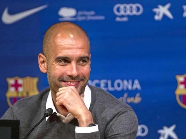 Barcelona-s-coach-Pep-Guardiola-smiles-during-a-press-conference-where-he-announced-his-resignation-AP-Photo-Emilio-Morenatti