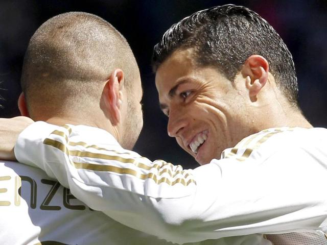 Real-Madrid-s-Karim-Benzema-L-is-congratulated-by-his-teammate-Cristiano-Ronaldo-after-scoring-against-Sevilla-FC-during-their-Spanish-first-division-soccer-match-at-Santiago-Bernabeu-stadium-in-Madrid-Reuters-Juan-Medina