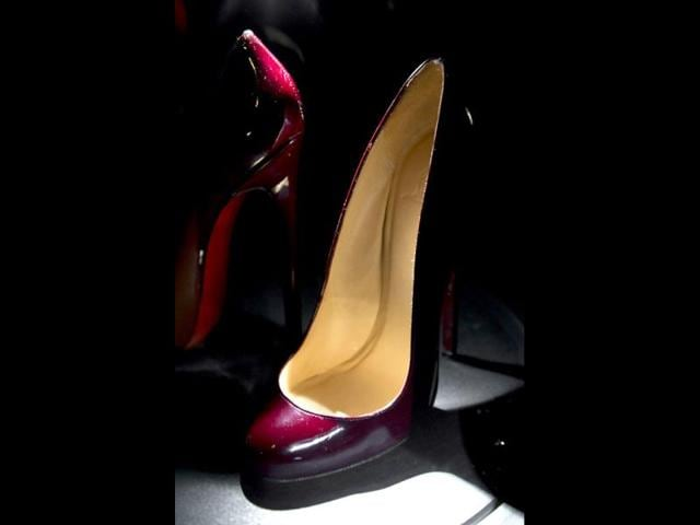French-shoe-designer-Christian-Louboutin-opens-his-first-ever-retrospective-exhibition-at-the-Design-Museum-London-The-exhibition-will-be-the-first-comprehensive-presentation-of-Louboutin-s-work-and-will-showcase-how-he-has-helped-transform-the-design-of-the-shoe-over-the-past-20-years-AP-Photo-Jonathan-Short