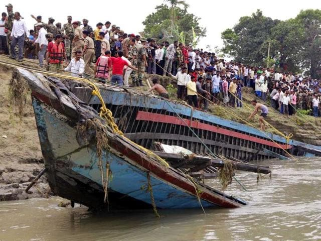 Rescuers-pull-out-the-wreckage-of-a-ferry-that-capsized-in-the-Brahmaputra-River-at-Buraburi-village-about-350-kilometers-west-of-Guwahati-AP-Anupam-Nath