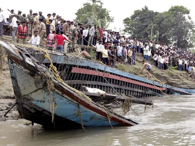 Rescuers-pull-out-the-wreckage-of-a-ferry-that-capsized-in-the-Brahmaputra-River-at-Buraburi-village-about-350-kilometers-215-miles-west-of--Guwahati-India-AP-Photo-Anupam-Nath