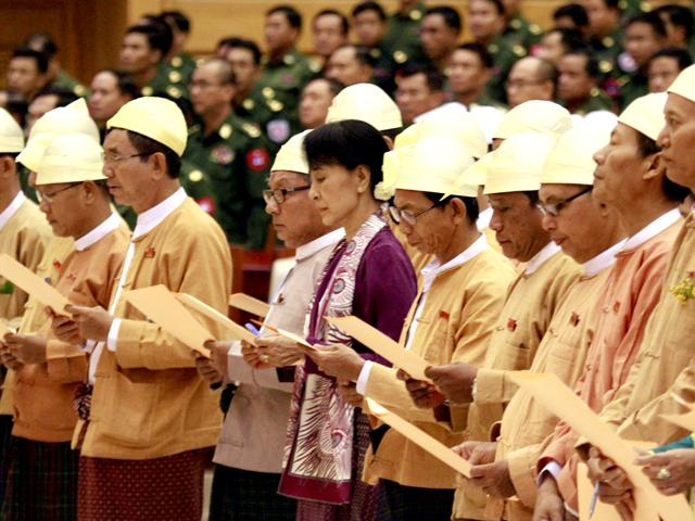 Myanmar-pro-democracy-icon-Aung-San-Suu-Kyi-registers-on-attendee-s-book-as-she-attends-a-regular-session-of-Myanmar-Lower-House-at-parliament-in-Naypyitaw-Myanmar--AP-Photo-Khin-Maung-Win
