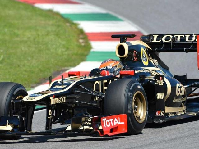 Lotus-F1-Team-s-French-driver-Romain-Grosjean-drives-at--Mugello-track-during-the-2nd-day-of-the-F1-official-test-session-AFP-Photo-Vincenzo-Pinto