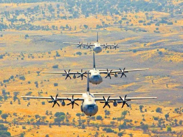 In-this-handout-photograph-released-by-the-ministry-of-defence-Indian-Air-Force-C-130J-Super-Hercules-transport-aircraft-fly-in-a-low-level-tactical-formation-during-the-Shoor-Veer-military-exercise-near-Hanumangarh-located-near-the-India-Pakistan-border-AFP-Ministry-of-defence