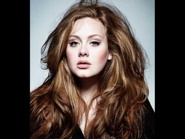 Adele-is-also-the-first-female-artist-to-have-three-singles-in-the-top-10-of-the-Billboard-Hot-100-at-the-same-time-and-the-first-female-artist-to-have-two-albums-in-the-top-five-of-the-Billboard-200-and-two-singles-in-the-top-five-of-the-Billboard-Hot-100-simultaneously