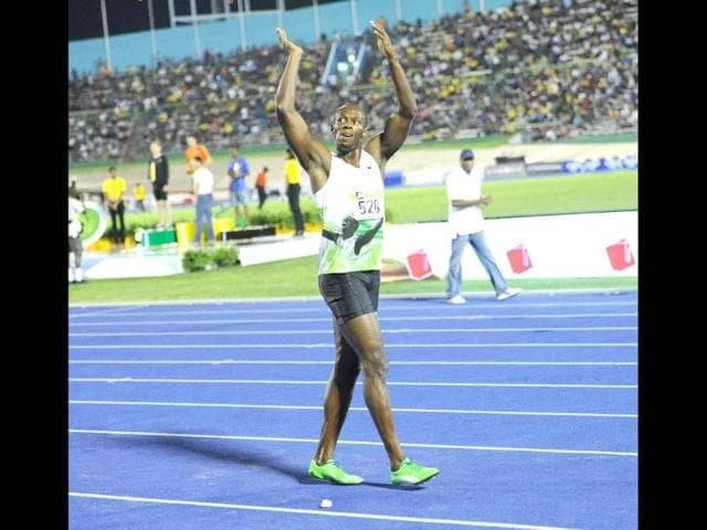 Jamaica-s-Usain-Bolt-acknowleges-the-large-crowd-after-running-a-world-leading-9-82-seconds-to-win-the-men-s-100-metre-at-the-Jamaica-International-Invitational-at-the-National-Stadium-in-Kingston-Jamaica-AFP-Ricardo-Makyn