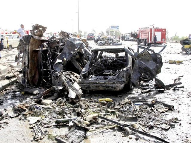 Damaged-cars-are-seen-near-the-site-of-an-explosion-in-Damascus-Two-explosions-shook-the-Syrian-capital-killing-and-wounding-dozens-of-people-in-a-district-that-houses-a-military-intelligence-complex-involved-in-President-Bashar-al-Assad-s-crackdown-on-a-14-month-uprising-Reuters-Khaled-al-Hariri