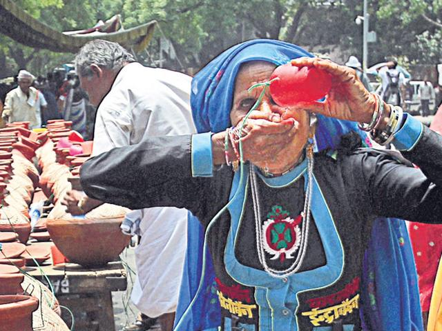 An-elderly-woman-takes-a-break-during-a-protest-to-demand-pension-for-elderly-at-Jantar-Mantar-in-New-Delhi-on-Thursday-Pension-Parishad-a-consortium-of-NGOs-and-trade-unions-received-an-unlikely-support-through-the-highest-office-in-India-when-President-Pratibha-Patil-made-a-personal-contribution-of-Rs-15-000-for-the-cause--PTI-PHOTO