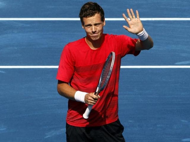 Tomas-Berdych-of-the-Czech-Republic-waves-after-his-victory-over-Fernando-Verdasco-of-Spain-at-the-end-of-their-men-s-singles-match-at-the-Madrid-Open-tennis-tournament-Reuters-Susana-Vera